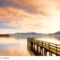 wooden jetty (140) on lake chiemsee with alps in background